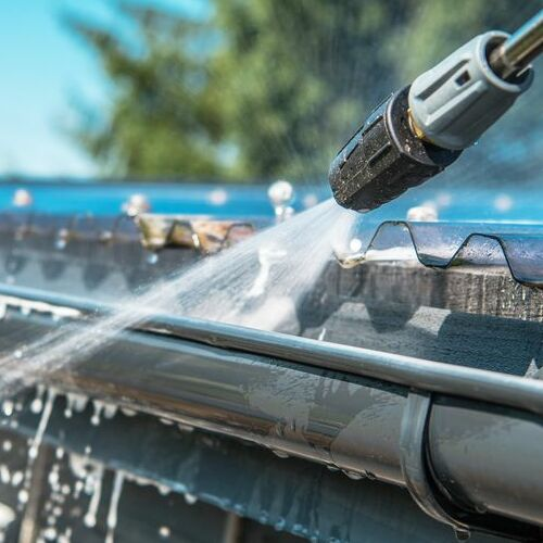 Amity Home Maintenance Uses High Pressure Hoses To Flush Gutters.