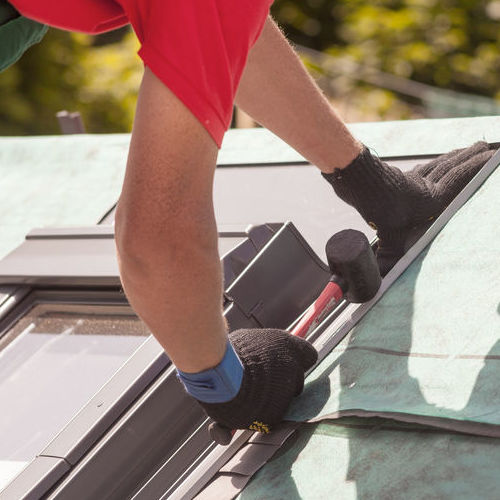 A Roofer Performs Skylight Repair.