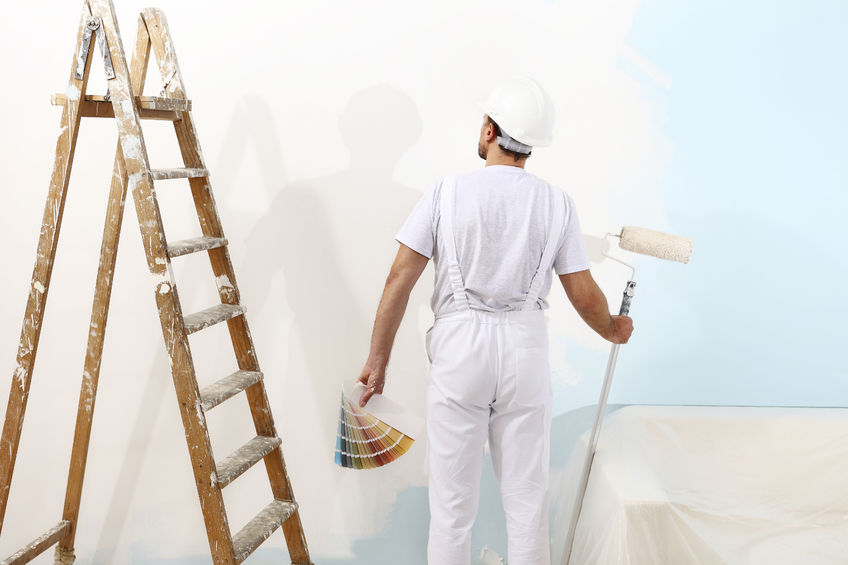 Painter Man at Work With a Paint Roller, Color Samples and Ladder
