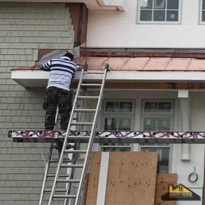 Roofer Installing Copper Panels